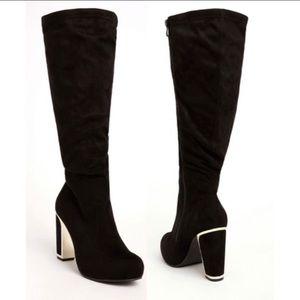 Torrid black knee high boots